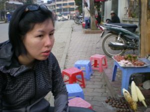 Me at streetside, waiting for my corn and sweet potato